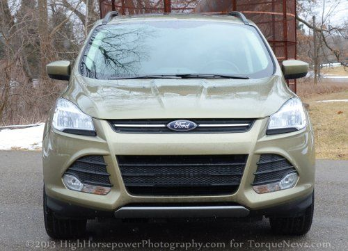 The front end of the 2013 Ford Escape SE in Ginger Ale